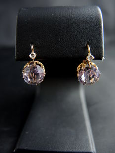 Antique dormeuse earrings made of rose gold, amethysts, and diamonds