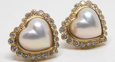Women's earrings with 2.20 ct diamond, and pearl.