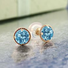 "14 kt yellow gold ear studs with ""Swiss Blue Topaz""."