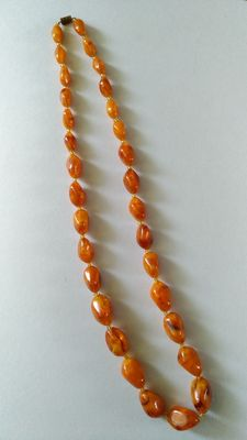 Old amber necklace Baltic amber.  Cognac colours, partly transparent.     39 g
