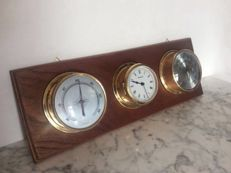 Weather station - ship's clock - barometer - thermometer.