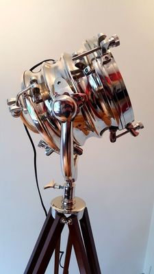 Luxury chromed lamp on tripod of brown lacquered wood