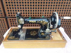 A gorgeous sewing machine of the brand Pfaff with wooden cover, Germany, ca. 1930
