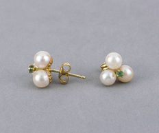 Yellow gold earrings, with three cultured Akoya pearls measuring 4.70 mm (approx.) in diameter, with emeralds set in prongs.
