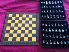 Chess and Moorish and Christian checkers in bronze 1975