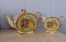 Lot with 10 English cups, teapot, and milk can