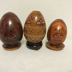 Three religious wooden eggs, hand-painted