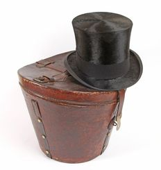 Antique leather hat box with top hat