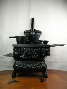 Miniature stove - cooker in iron with pots in Historism style - probably mid 20th century or older