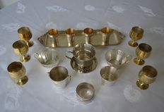 18 pieces in silver metal: cups, wine glasses, liqueur glasses on shelf, timbale and napkin ring, all stamped - France - XX