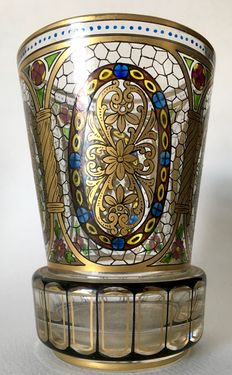 A Bohemian polychrome glass tumbler with floral, gilt decoration and foliate panels, late 19th / early 20th century