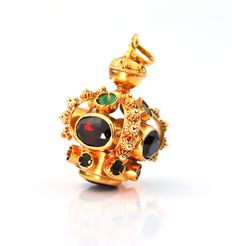 Intricately made charm in 18K Yellow Gold with garnets & green Amrod stones, ca. 1960