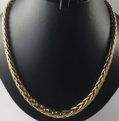 Gold palm link necklace.