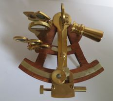 Naval Sextant in brass on wood