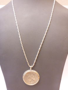Silver necklace with a silver peace dollar, 1923