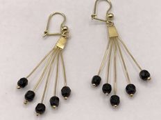 Pair of large gold earrings with garnet.