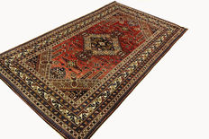 Antique Caucasian Oriental carpet 2.52 x 1.50 m. Authentic hand-woven carpet from 1930 Caucasus