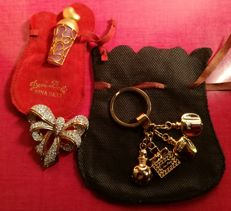 Lot of two (2) items: Christian Dior – Keychain – and Nina Ricci – brooches.