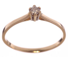 Yellow gold solitaire ring with 0.10 ct W-SI/P1  brilliant cut diamond