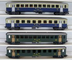 HAG H0 - 440/450/455/460 - 4 Passenger Carriages of the BLS, in green and crème/blue livery, with working interior lighting.