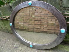Arts & Crafts hammered pewter mirror with four ceramic Ruskin cabochons - In the style of Liberty & Co