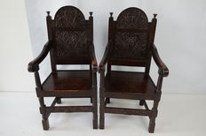 2 richly carved oak chairs - the Netherlands - 19th century