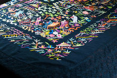 Manila shawl made in black silk, with Chinese embroideries depicting everyday scenes and floral motifs.