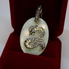 Sterling silver large pendant with oval cut Jade approx. 34x25mm and 10 peridots. Unisex.
