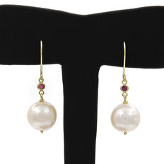Long earrings with a pair of fresh water pearls, approx. 10.75 mm in diameter, with rubies in a round setting.