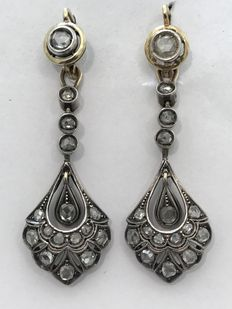 Earrings – Gold, silver and diamonds.