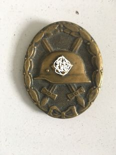 German WW2 Black wound badge marked L/11 and award document for a member of Panzer grenadier rgt 74 of the 19 panzer division