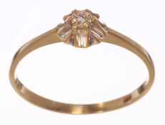 Gold, solitaire ring with octagon cut diamond of 0.01 ct.