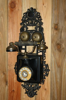 Old cast iron and brass decorative wall telephone