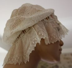Lot of two hats or caps in veil of white cotton with laces - France - end of the 19th century.