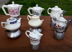 Seven old porcelain and aluminium coffee pots, suitable for collectors