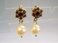 Gold earrings with garnet and genuine Akoya pearls