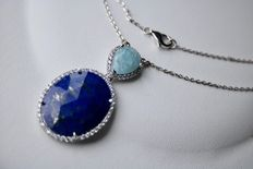 Sterling silver necklace with a very large pendant set with lapis lazuli and amazonite. Excellent condition.