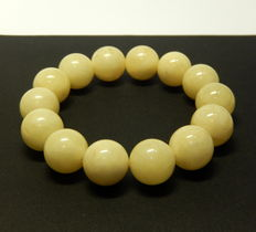 Bracelet in opaque white colour, Baltic amber 26 grams