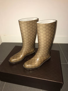 Gucci – Luxury boots.
