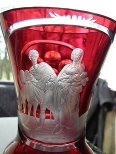 Red vase in cut glass representing the flight to Egypt, 20th century