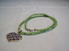 Emerald necklace 50 ct with sapphire heart-shaped pendant 3.25 ct