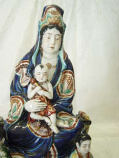 A large statue of Kannon (Guan Yin) with figures - Japan - 19th century.