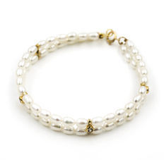 Yellow gold bracelet with 64 pearls and 4 zirconias