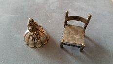 Two silver miniatures of an old Dutch chair, Holland, approx.1960, and a silver bride, 1980