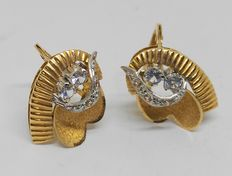 Set of 18 kt yellow gold earrings with zirconias