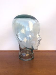 Vintage woman's head in glass.