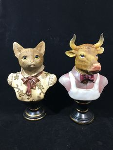 Two resin busts of a cat and a bull