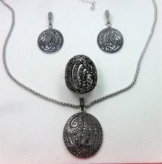 Set in 925 silver made up of long earrings, a ring, and a pendant and chain, studded with marcasites