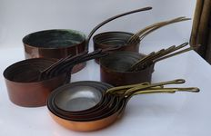 five sets of copper pans, one set is marked Portugal Tagus.