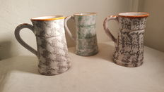 3 beautiful handmade terracotta mugs.